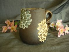 Ceramic Tea Cup with Zinnia  Flowers in Sky Blue, Sun Yellow and Dusk Purple and Black Mountain by Sally Anne Stahl. www.clayshapergallery.com
