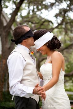 Bride and groom together before the ceremony but they are blindfolded so they can't see each other.