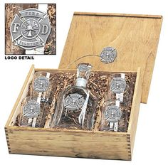 Fire Department Decanter Set. Includes a wooden gift box, a 24 oz decanter, and four 14 oz double-old-fashioned glasses. Each piece features a highly-detailed pewter Maltese Cross fire emblem.  | Shared by LION