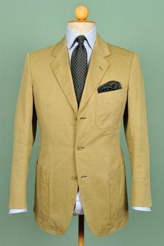 Beige jacket, light blue shirt, dark grey tie