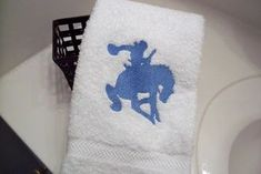 Give this bronc and rider design as a gift to that hard riding cowboy you know, Borgmanns Creations Rodeo Decorations, Hand Towels Bathroom, Rustic Home Interiors, Embroidered Towels, Gifts For Horse Lovers, Farmhouse Kitchen Decor, Kids Room, Room Decor, Gift Ideas