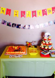 "Winnie the Pooh themed birthday party! Cake display and ""happy birthday"" banner #decor #banner #pooh #birthday"