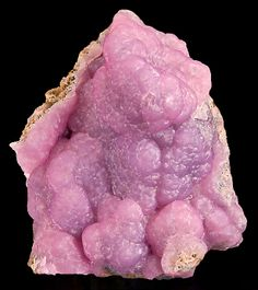 Lovely specimen of pink Smithsonite with lavender undetones on matrix! From Choix, Mun. de Choix, Sinaloa, Mexico. Measures 7.2 cm by 6 cm by 4.6 cm in total size. Price $785