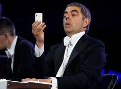"Comedic actor Rowan ""Mr. Bean"" Atkinson in a Bugs-Bunny-esque mockery of classic film scores."