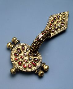 Fibula    Late 4th - early 5th century    Formerly Chernigov Province, the Village of Pashkovka   Russia (now Ukraine)    Silver, gold and cornelian; forged, soldered and decorated with inlay