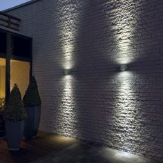Flush outdoor wall lights are perfect to go on the big empty wall. This will add some interesting pattern, accentuate the height of the building as well as add some lighting for the paths below.