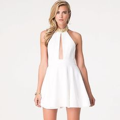 Embellished halter Bebe dress Gorgeous halter dress detailed with luxe embellished neckline and stunning fit and flare skirt. Open back and plunging front opening make you the center of attention. Banded hem. Button-loop and hidden back zip closure. Fully lined. bebe Dresses Backless