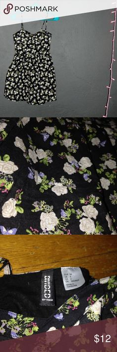 Floral F21 Dress This cute, black, princess style dress has little flowers all over it and is from FOREVER 21. Super adorable. Good condition. Forever 21 Dresses