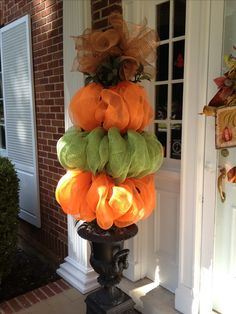 Pumpkin topiaries that I made using tomato stakes and deco mesh!!