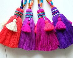 These stunning ethnic Thai tassels make a great addition to bags, accessories or home décor items. Choose from four different shades!* The tassels reflect the Thai people's love of rich, bold colours. Perfect for festival fashion or boho designs! Boho Designs, Diy Tassel, Tassels, Glands, Pom Pom Crafts, Festival Fashion, Decorative Items, Hand Embroidery, Creations