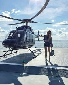 long legged woman in shorts being dropped off by private helicopter