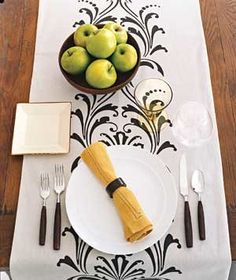 A pretty table runner laid down the length of a table can serve as both decoration and place mats.
