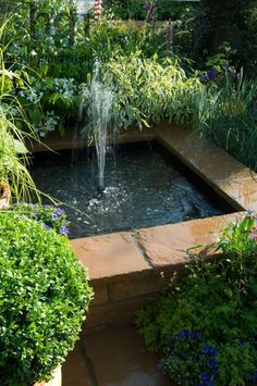 Harpur Garden Images :: 08MH210 Small square raised water feature pond pool fountain Design: Jeff Whiten Real Life by Bretts RHS Chelsea Flower Show 2008 Marcus Harpur