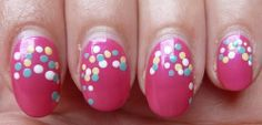 Pink nails with colored polka dots