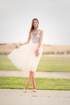 Space46 midi tule skirt and statement necklace from Uterque, Casadei blade nude pumps