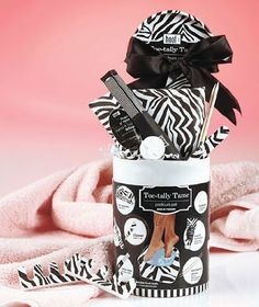 """10-pc. Pedicure Pail Toe Tally Tame Gift Set by LD Products. $23.95. A great pampering gift for her! It has everything you need for an instant, at-home pedicure like you'd get at a spa. Even includes an inflatable foot bath. Toe-Tally Tame features a sugar cookie scented lotion, and Mistle Toes comes with sparkling berries scented lotion. Pail, 7-1/2"""" x 5"""" dia."""
