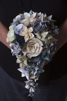 This bouquet features bo… Cascading handmade origami paper flower bridal bouquet. This bouquet … Book Flowers, Paper Flowers Wedding, Wedding Paper, Diy Flowers, Origami Flower Bouquet, Diy Bouquet, Flower Bouquet Wedding, Paper Flower Wedding Bouquets, Origami Wedding