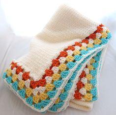 Cream Knitted Childrens Blanket with Granny Square Edge Orange Yellow Aqua Blue. $65.00, via Etsy.