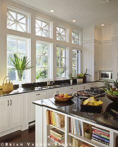 Casement windows. Note cabinets and microwave at corner.   Design: Group 3
