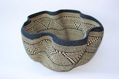 This beautiful basket, is organic in shape, reminiscent of a coral. These baskets are called Wave bowls for obvious reasons and are created by the most experienced and talented weavers in the Bolgatanga region of Ghana, renown for colourful basketry created from elephant grass.