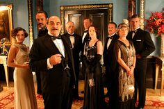 Cards upon the table. Poirot