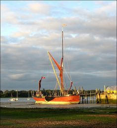 The early evening sun illuminates this Thames barge, which is moored at Pin Mill on the River Orwell, between Felixstowe and Ipswich in Suffolk. Suffolk England, Small Boats, Live In The Now, British Isles, Fishing Boats, Norfolk, Sailboat, East Coast, Evening Sun