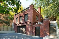 Carriage House with a patio. Photos: Artemesia, the biggest Craftsman ever built