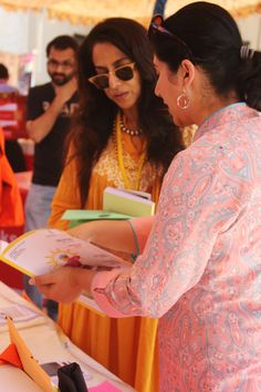 Indian novelist Shobhaa De visited DWL's stall at the Islamabad Literature Festival 2014.  Here DWL chief Afia Aslam is showing DWL's print magazine Papercuts to Shobhaa De.