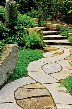 A stone walkway curves through the Vayo Meditation Garden.