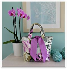 Lilac and grey version of my tied tote bag. I love to take photographs as much as I love to sew. If you like sewing or want to learn how to make original projects - aimed at beginners - we'd love to see you at our Etsy shop https://www.etsy.com/uk/listing/208575264/pdf-reversible-contrast-tied-tote-bag?