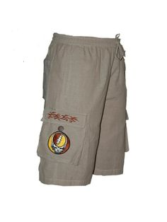 """Great buy for this summer!   Men's Licensed Grateful Dead Steal Your Face Khaki Cargo Shorts  Hand made in Nepal from 100% cotton. Skilled craftspeople working in kind conditions expertly craft each one by hand with close attention to detail. Durable but comfortable all natural fabric. An Officially Licensed Grateful Dead product.  Dimensions: Waist:28"""" stretches to 40"""", Length:22"""", Inseam:9"""""""