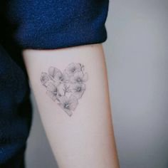 Single needle rose of Sharon heart tattoo on the left inner forearm.