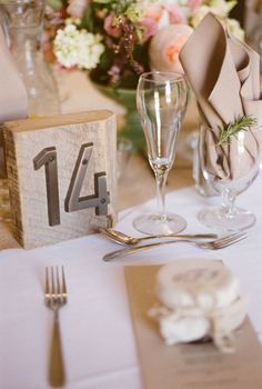 rustic wood and metal table numbers | photo: Amy Majors Photography