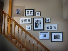 Gallery Wall - start with the biggest frame in center as a focal point and add around it.  Nice mix of frames for a clean look, and the balance of flow going up the stairs.