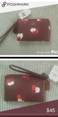"""Floral Corner Zip Wristlet Burgundy leather wristlet with red whit and purple floral design. Zip top closure. 2 card slots on the inside. 6"""" x 4"""" Coach Bags Clutches & Wristlets"""