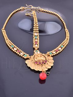RENT : #Antique #jewelries never fail to accentuate your #traditionalwear. This #maangtikka is decked with white, red and green stones with #Mahalakshmi design at the centre. The Mahalakshmi coins are beautifully placed surrounding the centre design. Flaunt your #traditionalwear with this amazing design.
