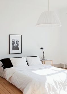To recreate this look at home - try www.naturalbedcompany.co.uk for white linen bedding, low solid wood beds and wireworks damian bedside table