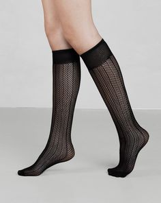Astrid knee high is a sophisticated fishnet pattered knee high sock with a micro-net look. Ideal to wear under pants with a great pair of shoes. This modern update of the fishnet pattern has a soft and feminine feel.