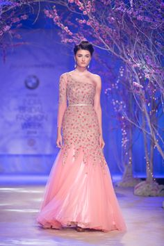Pink embroidered Indian wedding gown by Jyotsna Tiwari. More here: http://www.indianweddingsite.com/bmw-india-bridal-fashion-week-ibfw-2014-jyotsna-tiwari/