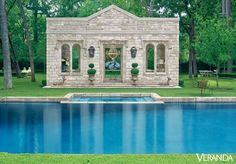 A French garden pavilion bound the pool. The antique stone, the door and window are French, with custom band detailing. DESIGN BY PAMELA PIERCE
