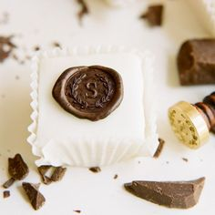 'A' initial chocolate seal; possible idea to top petit fours.