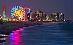 Myrtle Beach, SC Love the Sky Wheel lit up at night and the glare of the lights on the ocean waves.