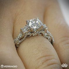 Love the diamonds on the side. Not sure about center stone. - Verragio Braided 3 Stone Engagement Ring | 1995