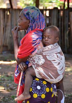 """Lala Salama"". Kenyan woman carrying her sleeping child at Funzi Island, Kenya. by One more shot Rog on Flickr."