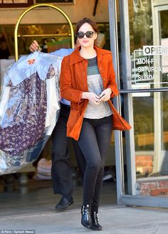 The Girl With Dry Cleaning To Do: Dakota Johnson picks up clothes as Melanie Griffith shares throwback mother-daughter tattoo snap