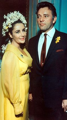 Elizabeth Taylor and husband Richard Burton fell in love during filming of CLEOPATRA.  They married in Montreal, in 1964 ~ nine days after her marriage to Eddie Fisher ended.  The bride wore an   empire-style yellow chiffon gown, with lily of the valley and white hyacinth blossoms in her hair