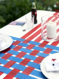 Could be done in any color for a wedding! 4th of July Table Runner  Cover a table with a white paper tablecloth; snip lengths of blue and red crepe paper to the lengths of the cloth. Weave the colors, as shown; affix at tables edges with double-sided tape.    Read more: Fourth of July Party Decorations - Patriotic Decoration Ideas - Good Housekeeping
