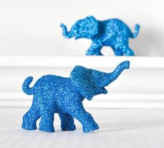 Take any old sculpture and turn it into a super cute accessory to the baby room..hmmm lots of ideas on this one.