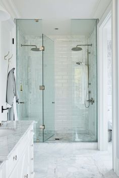 Home Decor and Lifestyle from Hello Lovely Studio: Spa like marble master bath with glass shower and double showerheads