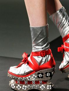 4. Prada How do we not love thee? Let us count the ways. 1. Leather sandal socks. 2. Double decker platforms. These Geisha-inspired shoes stomped the runway back in 2012 for Prada's Spring/Summer 2013 collection. We're all for sandals, but somehow this look misses both the comfort and style marks. Source: Pinterest  #flipflop #heel #freeyourtoes